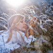Woman in feather grass - Stock Photo