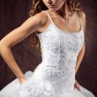Fashion model wearing wedding dress - Stock Photo