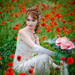 Girl sitting among poppies — Stock Photo #1246105