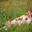 Beautiful girl in grass — Stock Photo