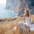 Stock Photo: Bride at beautiful landscape