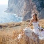Bride at beautiful landscape — Stock Photo