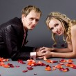Wedding couple among rose petals — Stock Photo #1246741