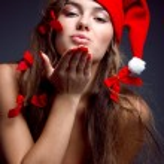 Kissing santa helper girl — Stock Photo