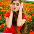 Woman and tulips — Stock fotografie