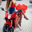 Fashion model on motorcycle — Stock Photo