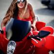 Fashion model on motorcycle — Stock Photo