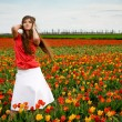 Beautiful woman in tulips field — Stock Photo