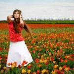 Beautiful woman in tulips field — Stock Photo