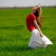 Stock Photo: Beautiful woman in meadow