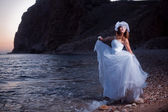 Bride on sunset beach — Stock Photo