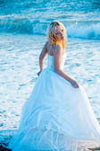 Bride in sea water — Stock Photo