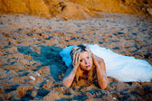Bride on sand at beach — Stock Photo