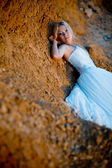 Bride lying on rock — Stock Photo