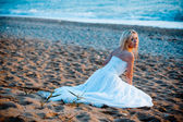 Bride at beach — Stock Photo
