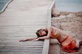 Sad girl on beach — Stock Photo