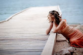 Girl on berth near sea — Stock Photo