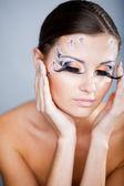 Colorful ceremonial makeup — Stock Photo