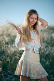 Rural girl with buch of feather grass — Stock Photo