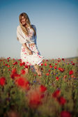 Smiling girl in field of flowers — Stock Photo