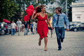 Running teenage couple — Stock Photo