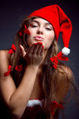 Kissing santa helper girl — Stock Photo