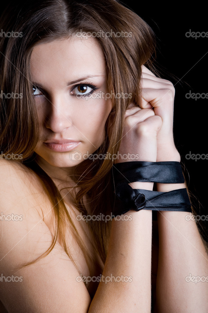 Portrait of young beautiful sexy model on black  Stock Photo #1242276