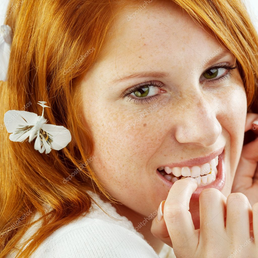 Photo of beautiful young girl with red hair and freckled skin on her face, square composition — Stock Photo #1244217