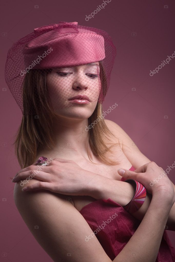 Soft portrait of beautiful elegant model in hat with veil in pink color  Stock Photo #1245329