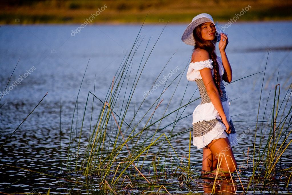 Sexy model posing in lake water in sunshine — Stock Photo #1245545
