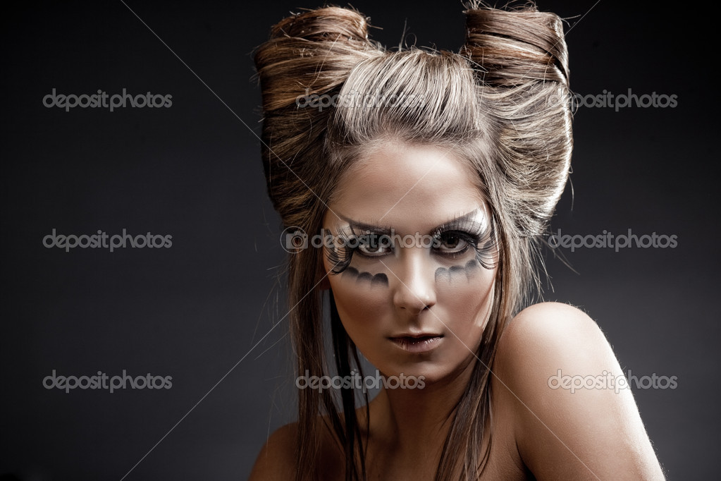 Fashion model with halloween makeup and hairstyle on black studio background — Stock Photo #1246252