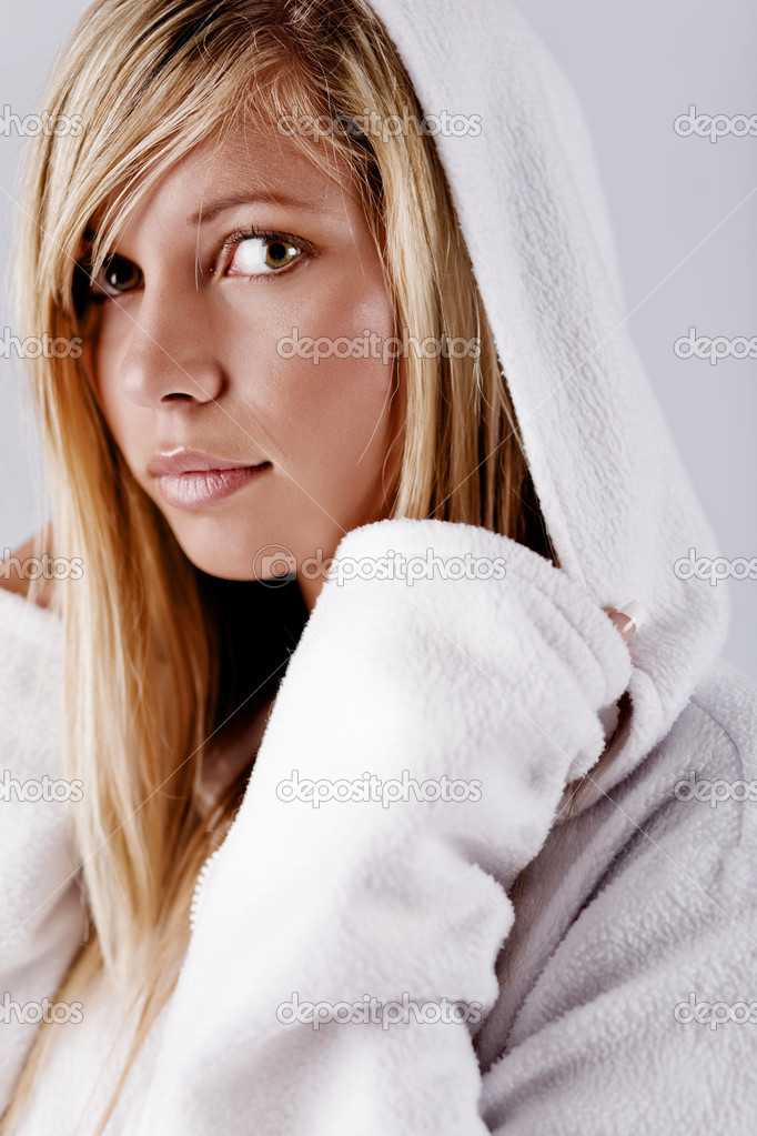 Blond beautiful girl wearing white fleece hood posing at studio  Stock Photo #1246607