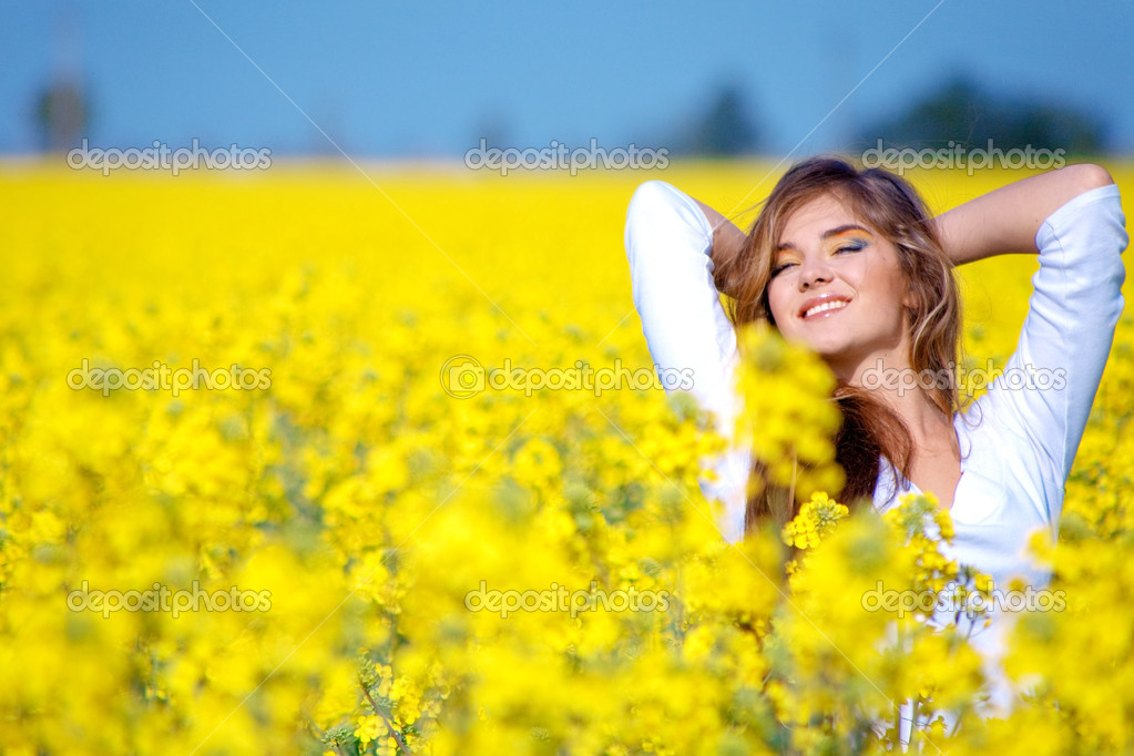 Girl relaxing in field of flowers — Stock Photo © alenkasm ...