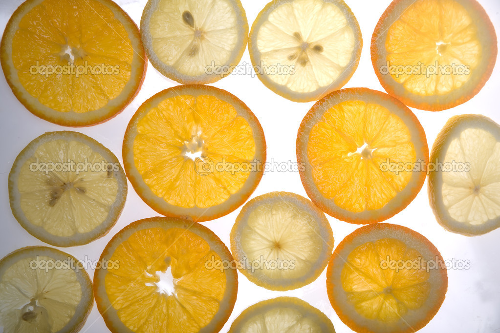 Slices of oranges and lemons lighting through  Lizenzfreies Foto #1249751