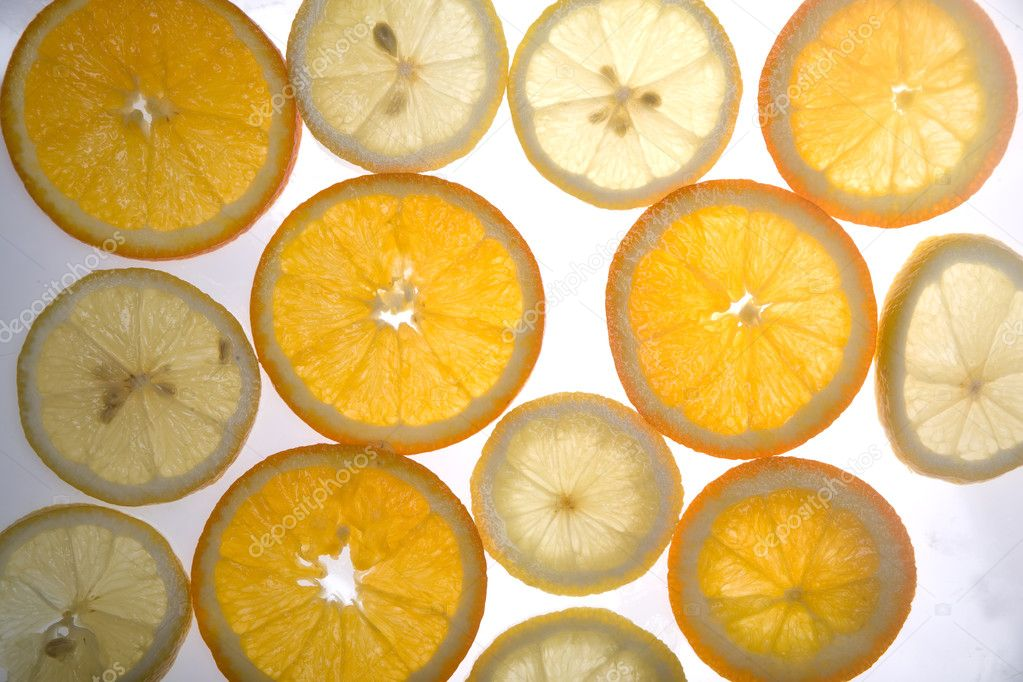 Slices of oranges and lemons lighting through — Stock fotografie #1249751