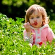 Baby playing in grass — Stock Photo