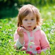 Little girl in grass — Stock Photo