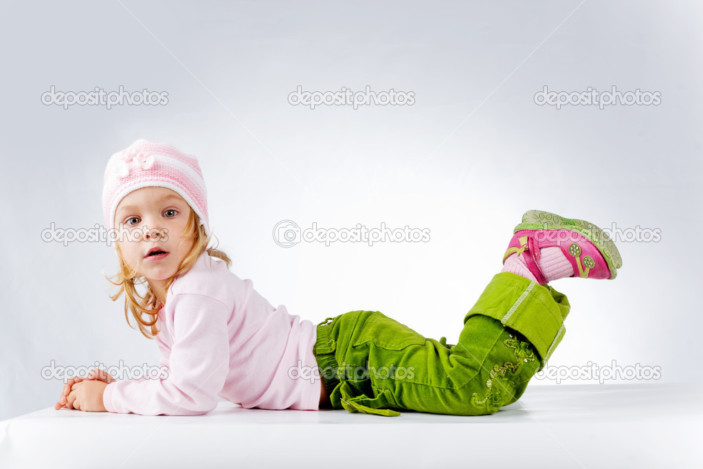 Little funny girl on white background studio shot  Stock Photo #1251052