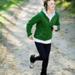 Girl runner in the forest — Stock Photo #1184371