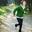 Stock Photo: Girl runner in the forest