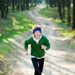Girl runner in the forest — Stock Photo