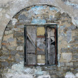 Old stone wall with a window — Stock Photo