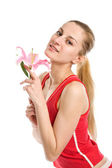 Nice girl with a pink lily — Stock Photo