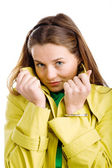 Woman in yellow raincoat — Stock Photo