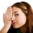 Woman covering her eye — Stock Photo #1241502