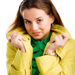 Stock Photo: Womin yellow raincoat