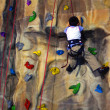 Stock Photo: Little boy Climbing Wall