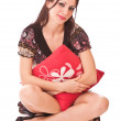Lovely girl with pillow — Stock Photo