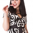 Lovely girl brunette with sugar candy — Stock Photo