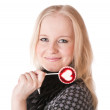 Lovely girl blonde with lollipop — Stock Photo